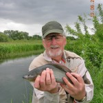 Dr Tony Brothers with his first Grayling - picture by Philip Bailey
